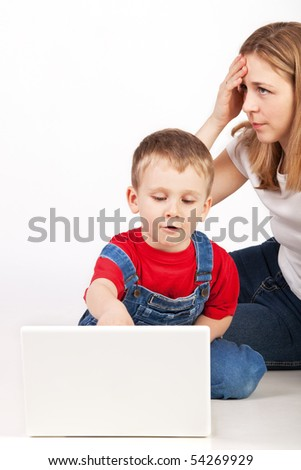 Family with laptop on the floor