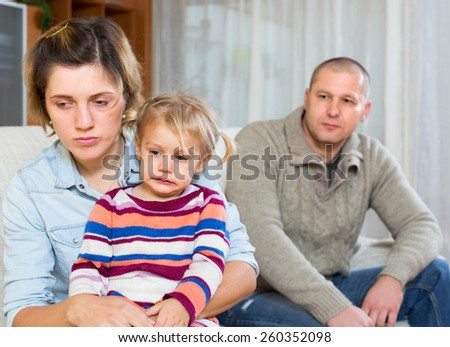 Family with little child having conflict at home - stock photo