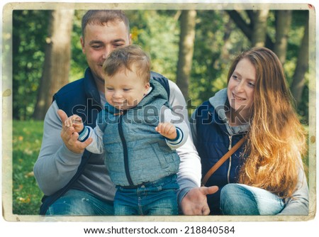 family with little child in the park