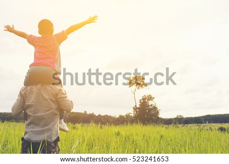 Family with mountain view,Or Father and son are happy with travel and picnic with mountain and sunshine view.2