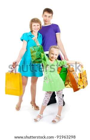 family with shopping bags on white background