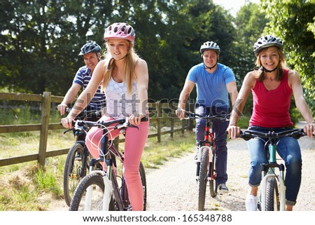 Family With Teenage Children On Cycle Ride In Countryside - stock photo