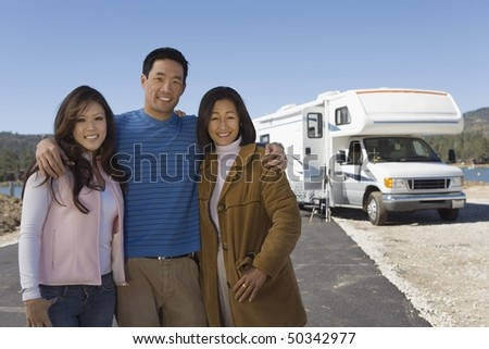 Family with teenage daughter outside of RV - stock photo