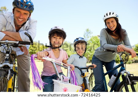 Family with their bikes - stock photo