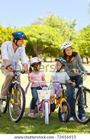 Family with their bikes in the park