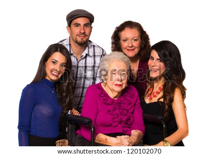 Family with their handicapped grandmother on a white background. - stock photo