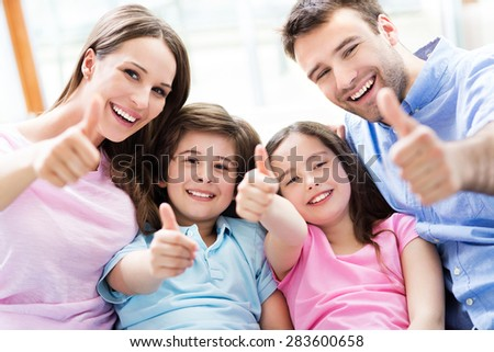 Family with thumbs up  - stock photo