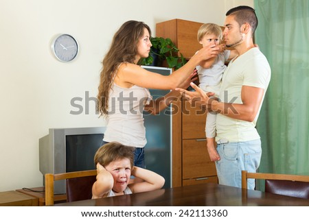 Family with two children discussing problems at home - stock photo