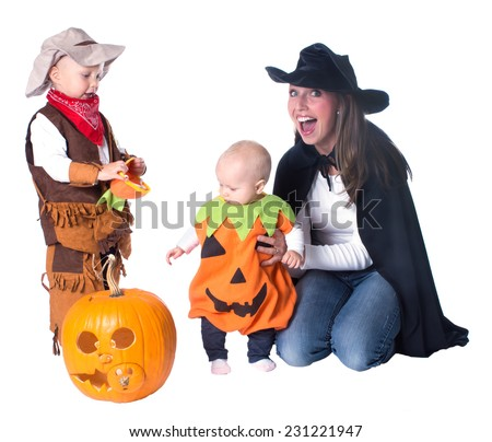 Family with two children in costume on Halloween