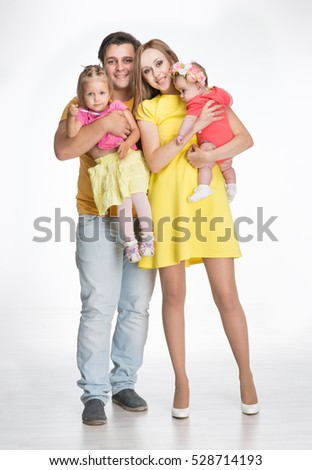 Family with two children in the studio