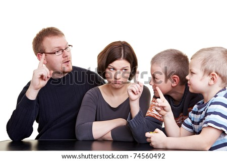Family with two children voting with hand signs - stock photo