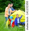 Family with two kids doing camping in the park - stock photo