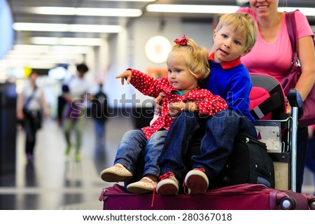 family with two kids travel in the airport, family travel - stock photo