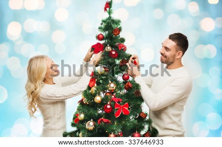 People Decorating For Christmas christmas tree toys stock photos - people images - shutterstock