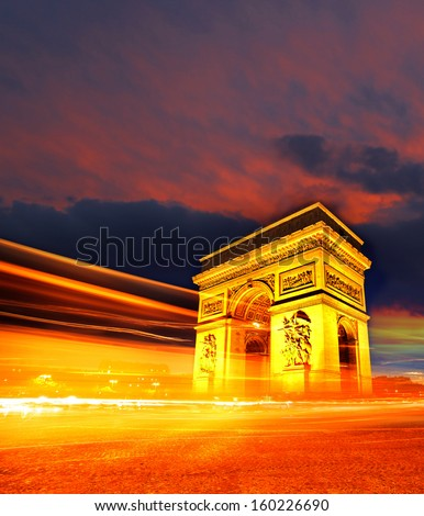 Famous Arc de Triomphe in the evening,  Paris, France - stock photo