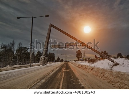 Famous Arctic Circle road at winter Sunset