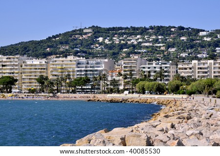 Famous bay of cannes in France with the beach and buildings in the background - stock photo