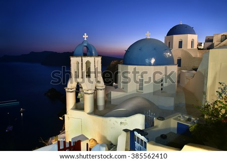 Famous blue dome churches in Oia Village, Santorini, Greece - stock photo