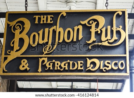 Famous Bourbon Pub in New Orleans French Quarter - NEW ORLEANS, LOUISIANA - APRIL 18, 2016  - stock photo