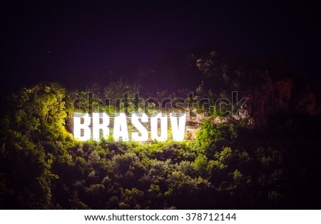 Famous Brasov letters on the Tampa hill during night, Romania - stock photo