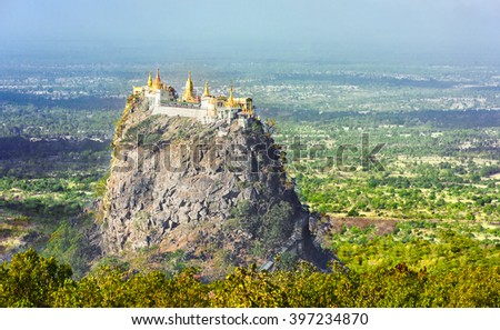 Famous buddhist temple on the summit of Taung Kalat volcano near Mt. Popa. 777 stairs have to be climbed barefoot along with monkeys to reach the top, end of pilgrimage. Myanmar - stock photo