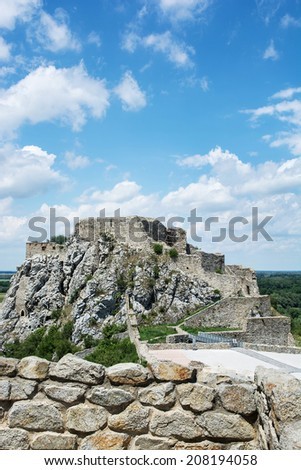 Famous castle Devin with blue cloudy sky. Slovakia, Central Europe. - stock photo