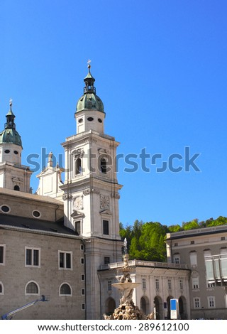 Famous cathedral and Residenzbrunnen fountain on Residenzplats, Salzburg, Austria - stock photo