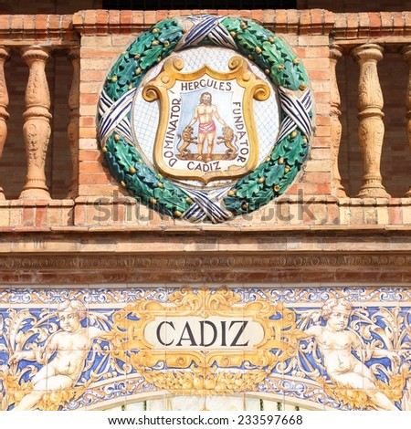 Famous ceramic decoration in Plaza de Espana, Sevilla, Spain. Coat of arms of Cadiz. Square composition. - stock photo