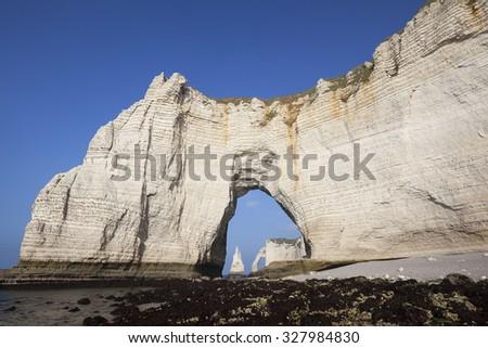 Famous chalk cliffs at Cote d'Albatre (Alabaster Coast). Etretat, France - stock photo