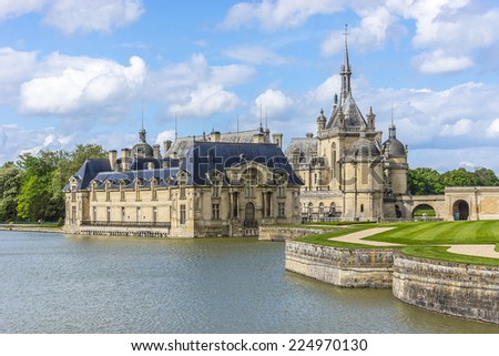 Famous Chateau de Chantilly (Chantilly Castle, 1560), is a historic chateau located in town of Chantilly, Oise, Picardie, France. - stock photo
