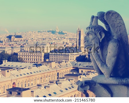 Famous Chimera (demon) of Notre Dame overlooking the Paris.Image with a vintage retro instagram filter  - stock photo