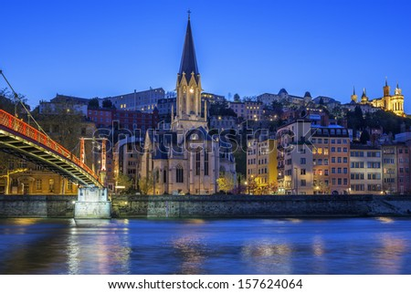 Famous church in Lyon with Saone river at night - stock photo