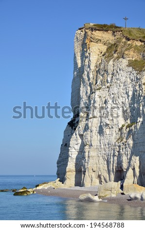 Famous cliff of  Fecamp with calvary, commune in the Seine-Maritime department in the Haute-Normandie region in northwestern France - stock photo