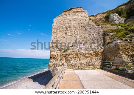 Famous cliffs Aval of Etretat. Etretat is a commune in the Seine-Maritime department in the Haute-Normandie region in northwestern France. Etretat is now a famous French seaside resort.. - stock photo