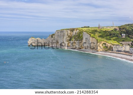 "Famous cliffs ""d'Amont"" of Etretat. Etretat is a commune in the Seine-Maritime department in the Haute-Normandie region in northwestern France. Etretat is now a famous French seaside resort. - stock photo"