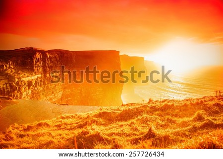 Famous cliffs of Moher at sunset in Co. Clare Ireland Europe. Beautiful landscape as natural attraction. - stock photo