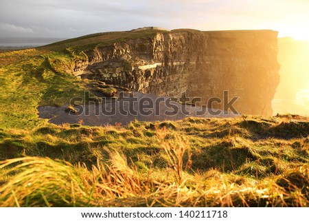 Famous cliffs of Moher at sunset in Co. Clare Ireland natural attraction - stock photo