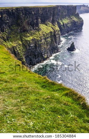 Famous cliffs of Moher with tower. Ireland - stock photo
