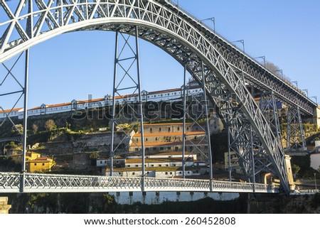 Famous Dom Luis I Bridge in Porto, Portugal. - stock photo