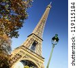 famous Eiffel Tower and trees in Paris, France - stock photo