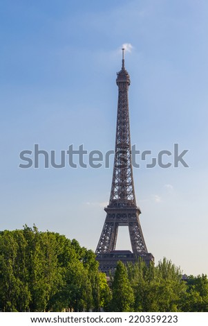 Famous Eiffel Tower on a sunny summer day in Paris, France.