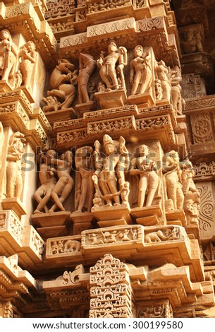 Famous erotic human sculptures at temple in Khajuraho, India - stock photo