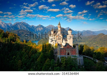 Famous fairy tale Castle in Bavaria, Neuschwanstein, Germany,  morning with blue sky with white clouds  - stock photo