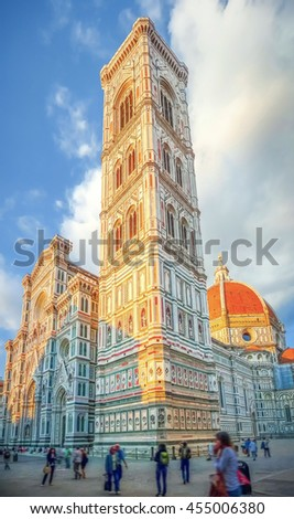 Famous Giotto's Campanile with Cathedral Santa Maria Del Fiore on Piazza del Duomo in Florence with blue sky in beautiful golden evenig light at sunset, Tuscany, Italy - stock photo