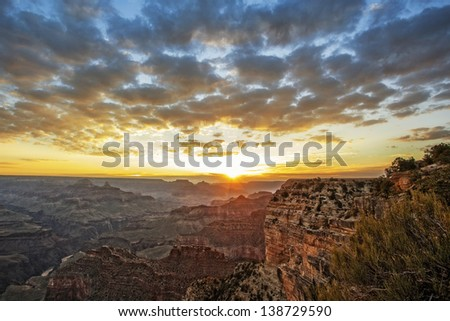 Famous Grand Canyon at sunrise, horizontal view - stock photo