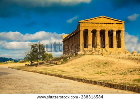 famous Greek ruins of Concordia Temple in the Valley of Temples at the sunset near Agrigento, Sicily - stock photo