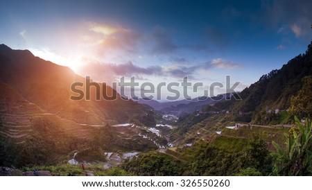 Famous Ifugao Philippines rice terraces at sunset - stock photo