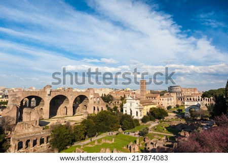 Famous italian landmark: the ancient Roman Forum (Foro Romano) with the Colosseo in background. Rome, Italy, Europe.