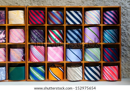 Famous Italian silk ties made at Lake Como on display outside in wooden boxes - stock photo