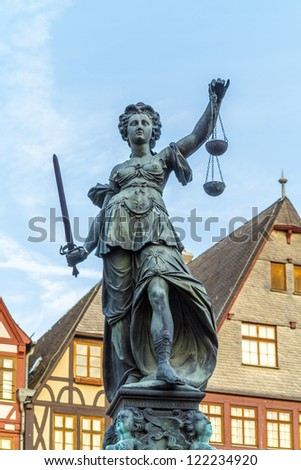 famous lady justice in Frankfurt under blue sky - stock photo